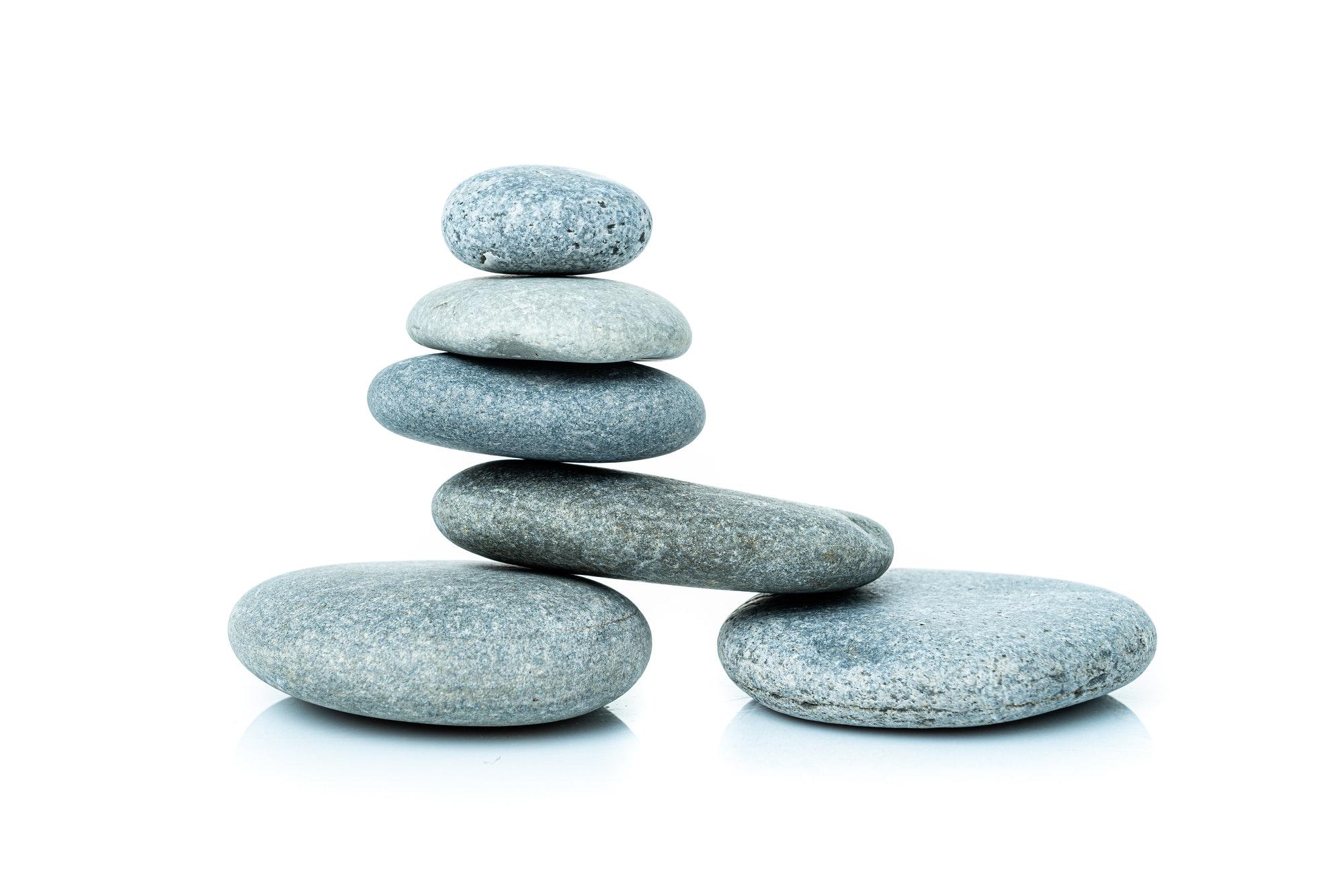 Stacked harmony stones in zen balance. pile of stones isolated on white background